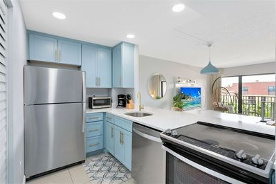 Fully equipped kitchen with brand new appliances & in unit washer & dryer!