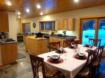 Dining area off of open kitchen. Table will seat 8 (only 6 chairs are shown).