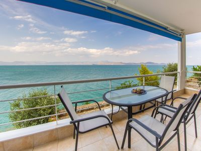 Photo for Beachfront Holiday Apartment with amazing Sea View