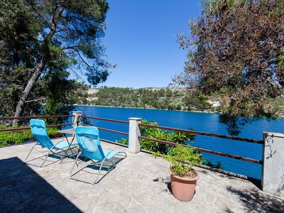 Photo for Romantic seafront house with big garden and private mooring