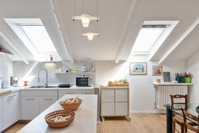 The kitchen is fully equipped with dishwasher, microwave, stove, kettle,toaster