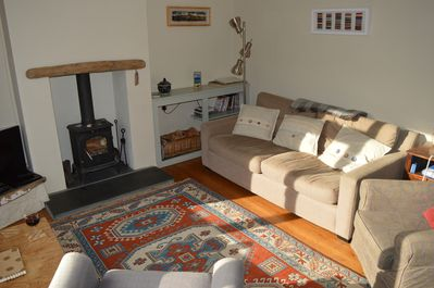 The living room with cosy wood burner