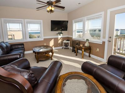 Photo for Stunning Semi-oceanfront penthouse condo - ocean views, pool, & easy beach access. Central location (SP301S - Jazzie Shore)