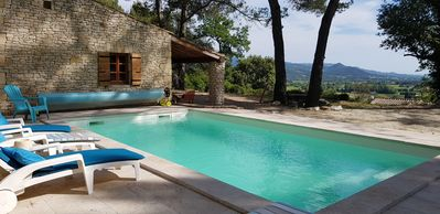 Photo for Le Petit Paradis, stone house, swimming pool, exceptional view
