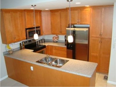 Photo for Nicely Furnished Modern Condo only minutes from Skiing & Snowmobiling