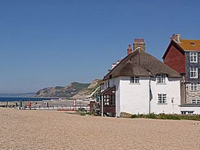 Photo for Thatched Cottage On The Beach With Sea Views
