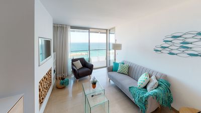 Photo for Elegant apartment with direct access to the beach