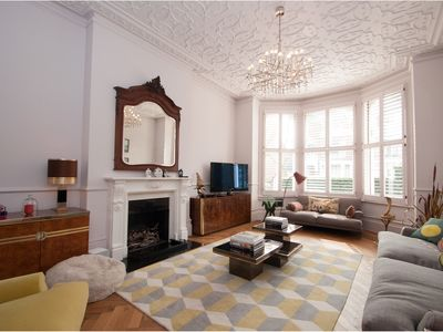 Photo for Magnificently grand 5 bed house with huge garden in a chic west London (Veeve)