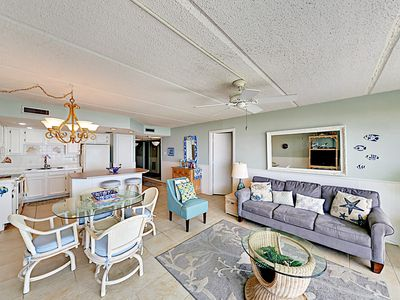 Living Area - The living room combines the charm of coastal-inspired decor with comfortable seating.