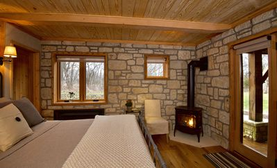 Willow room equipped with gas fireplace and french doors opening onto patio