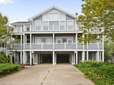 Photo for FREE DAILY ACTIVITIES!!! Amazing vacation opportunity and brand new to the rental market!   Fabulous 4 bedroom plus den beach home has 3.5 baths featuring open concept living with inverted floor plan and spacious rooms.