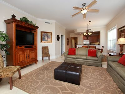 Spacious, open living room and dining area.  Large, flat screen TV and Blu-Ray