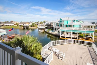 Deck - Welcome to Galveston! Your canal-front home is professionally managed by TurnKey Vacation Rentals.