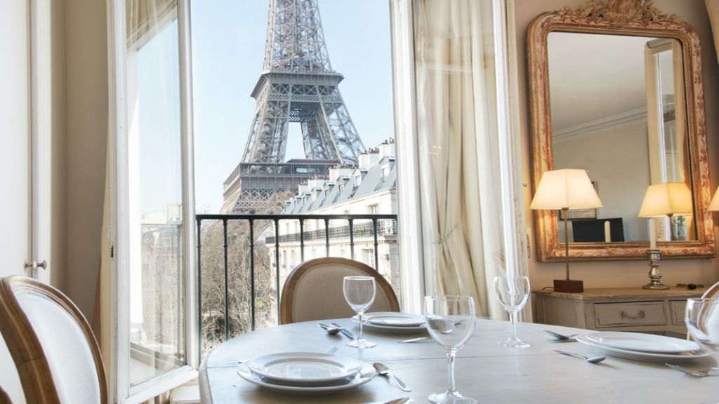 dining with eiffel tower view. gros-caillou apartment rental - elegant dining table with straight-on eiffel tower views view