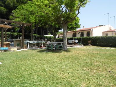 Photo for Villa with pool + free wifi in a green oasis just steps from the sea.-