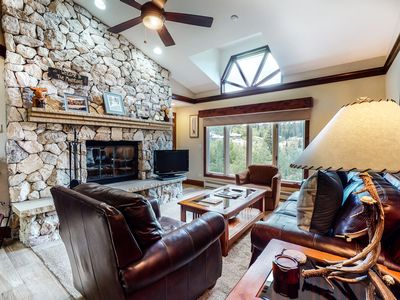 Photo for 4th floor chalet-style condo w/ WiFi, wood-burning fireplace - walk to lifts!