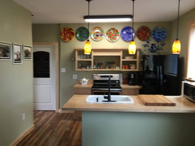 Photo for Hawaiian Style Cottage located in the heart of Naalehu. HOT TUB and new deck!