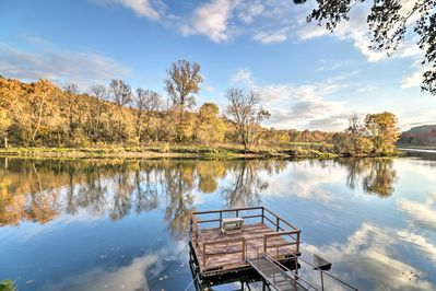 Soak in this view of the Norfork River during your stay at this Salesville home!