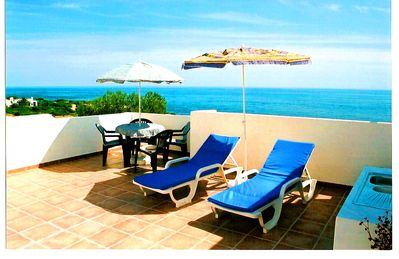 Photo for Rooftop terrace with fantastic sea views, 3 minutes to the beach, WiFi, quiet location