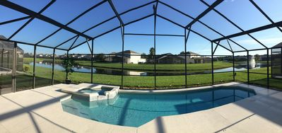 Photo for Stunning Lakeside Villa, Pool & Spa. 4BR/3BA - Gated Community - Disney 12 Mins