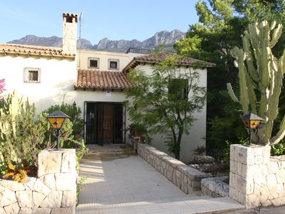 Photo for Villa with private pool on the golf with mountain views