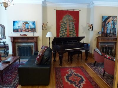 double living room two fireplaces, 1850 square Chikering piano