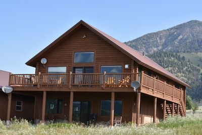 Large deck wraps around side of cabin.