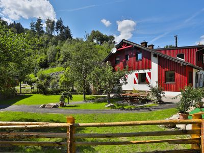 Photo for Smiley's romantic river chalet on the crystal clear Lieser river