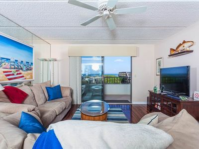 Windjammer 110 comfortably sleeps six - Relax in the beautiful living room while you watch TV, enjoy a good chat, or just sit back and let the ocean breezes surround you. Bring out the board games to enjoy a fun night of Monopoly!
