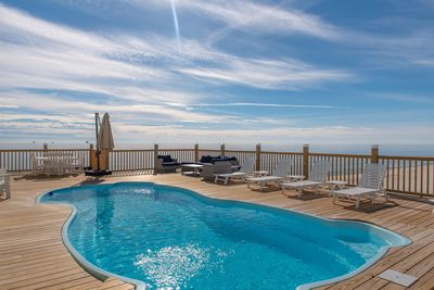 Large saltwater pool overlooking the Gulf Beach. Comfortable seating!