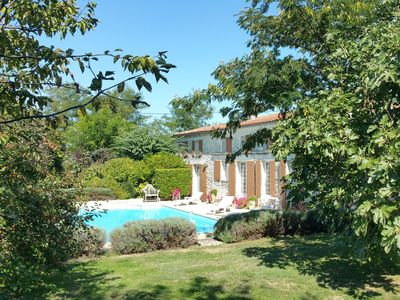 Photo for Beautiful stone charantais farmhouse with private pool, in convenient location