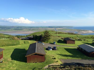 Photo for Cosy Swiss-Style Wooden Chalet in Aberdovey, Snowdonia with stunning sea views