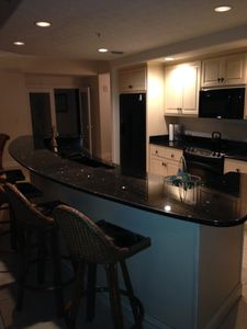 Granite Counters in the kitchen including a HUGE bar with 4 bar stools