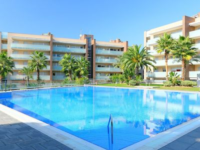Photo for Cosy apartment with pool, A/C, hot tub, TV, balcony, washing machine and parking