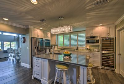 The stunning kitchen comes fully equipped with updated appliances.