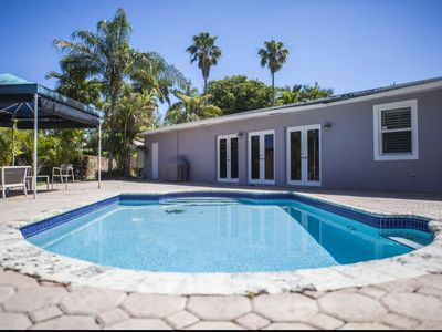 Photo for Contemporary Family Home with Pool, Huge, Fenced Yard & Minutes from Best Attractions & Beach