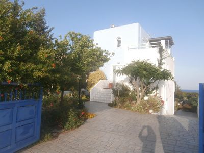 Front of villa with front garden and view of back garden directly to the beach.