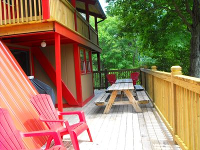 Lower level party deck. Perfect for large gatherings and quaint meals outside!