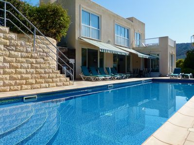 Sea-facing villa with 13m long pool , wide patio and lush flower gardens