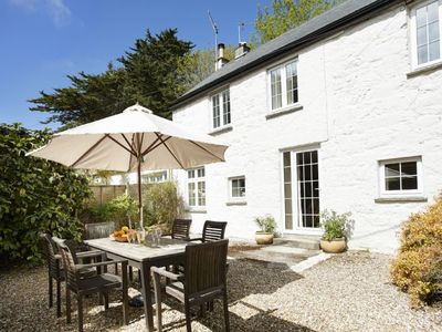 Photo for Mews Cottage in Cornwall sleeps six people and even features a cosy fireplace.