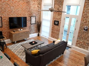 """Entertainment Themed-The Picayune, Historic luxury condo with balcony, 2 blocks from French Quarter"""""""