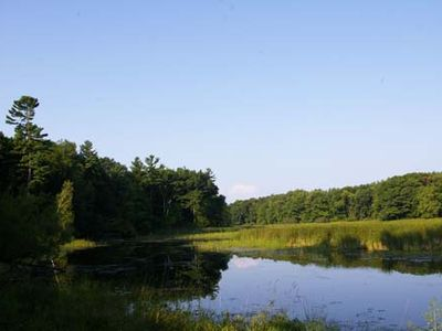 Photo for Nature Lover's Cottage Retreat On The Black River With Private Dock.