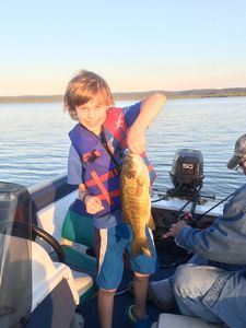 Happiness is his first keeper Small Mouth Bass.