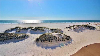 CLEARWATER BEACH FAMOUS FOR ITS SUGAR WHITE SAND AND CRYSTAL BLUE WATERS .