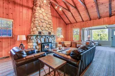 The family room is rustic knotty pine with a gas log fireplace.