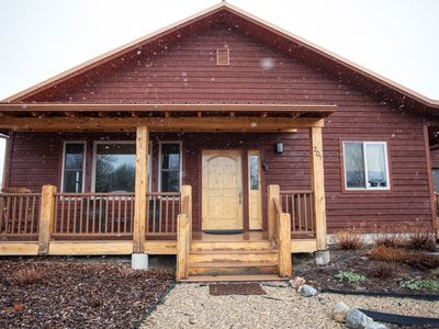 Photo for Spacious, pet friendly 3 bedroom with hot tub - IN TOWN!