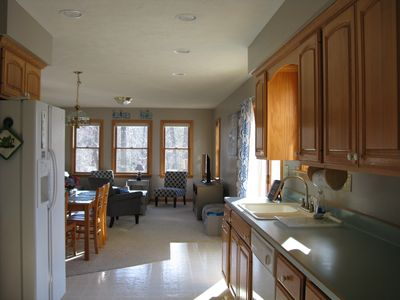 kitchen, dining area and living room.