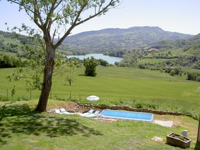 Photo for Lovely apartment with pool, private garden and stunning lake and mountain views