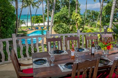 Monkey Beach House- Dining area with pool and seaviews