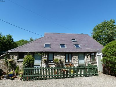Photo for This five star Welsh country cottage with hot tub really is the ideal setting for your luxurious and